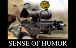 Sniper with 'happy face' sticker on flipped up scope cover