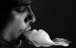 Man exhaling smoke